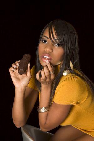 glamorous portrait of young beautiful woman eating chocolate Stock Photo - 2570718