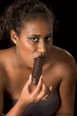 glamorous portrait of young beautiful woman eating chocolate Stock Photo - 2570719