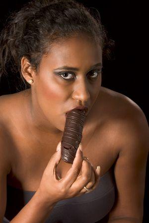 glamorous portrait of young beautiful woman eating chocolate Stock Photo - 2570719