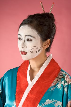 Asian female with geisha style face paint in yukata (kimono) Stock Photo - 2640384