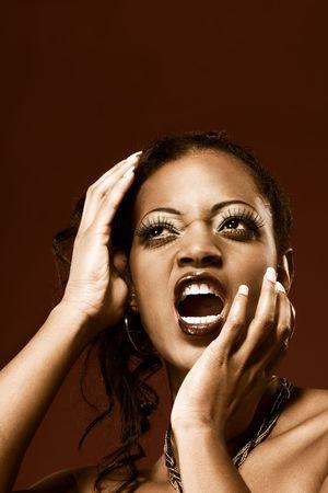 Emotional, screaming young beautiful sexy woman Stock Photo - 2676321