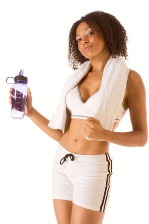 Dark skinned female in sporty outfit holding bottle of water  photo
