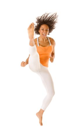 martial arts woman: Tanned fit sporty female jumps and kicks  Stock Photo