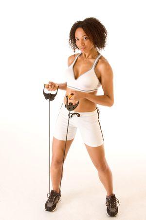 Dark skinned female stretching using rubber band photo