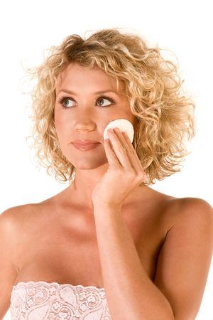 removing: Beautiful blonde removing facial make-up