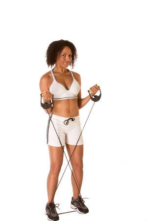 swarthy: Dark skinned female stretching using rubber band Stock Photo