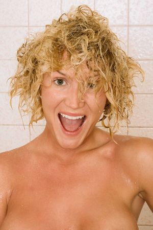 Blond girl with wet hairs after taking shower Stock Photo - 3121623