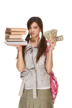 Asian college student with backpack balance pile of books and money in here hands with very concerned expression photo