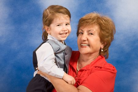 Portrait of grandmother holding two year old boy smiling and happy photo
