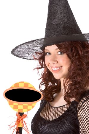 Portrait of Latina teenager girl in black Halloween hat and fishnet dress holding blank black sign photo