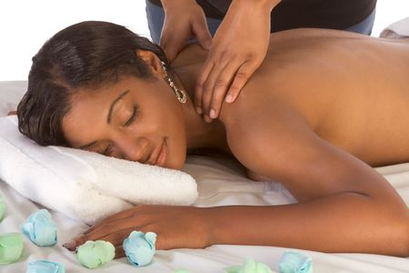 Beautiful young black female is relaxing while being massaged in spa Stock Photo - 3446956