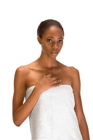 slicked: Beautiful young African-American woman with Slicked Back Hair wrapped in white bath towel preparing for sauna Stock Photo