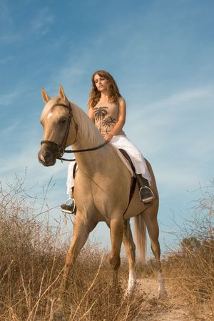 only women: Young female riding on horse Stock Photo