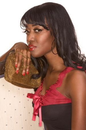 afro american nude: Portrait of Attractive sensual glamorous Afro-American female holding expensive looking gold handbag  Stock Photo