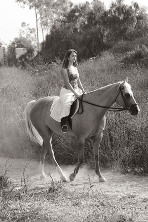 quarter horse: Attractive girl riding on horse in deserted rural location