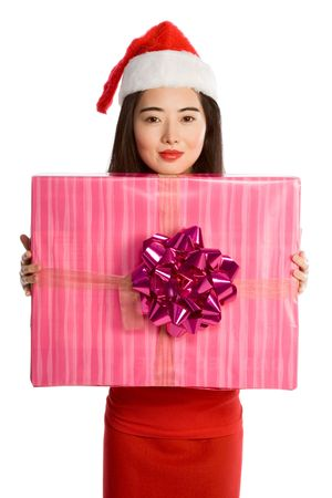 Attractive Chinese girl - Mrs Santa Claus, with very big gift box wrapped in pink paper and decorated by gigantic magenta bow photo