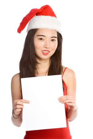 Mrs. Santa Claus template; attractive Chinese woman holding blank sheet of white paper in front of her. This empty area may be used as copy space to put advertisement or announcement, or any other required text  photo