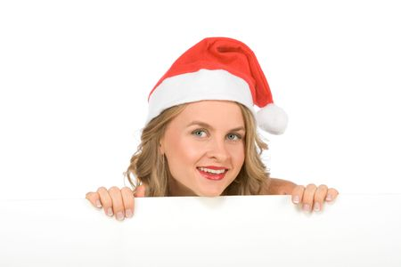 Sexy blonde young woman in Mrs Santa Claus hat holding a blank sign. Isolated on white. Extra white space with your message can be added to the bottom of the picture photo