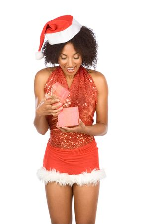 Excited dark skinned female in sexy outfit opening gift box with holiday present and extremely happy discovering its content photo