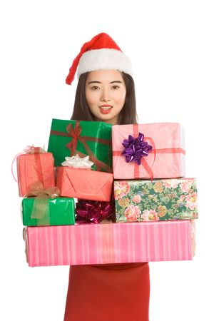 Excited Asian girl Santa Claus hat with pile of Christmas gifts wrapped in colorful paper and decorated by bows Stock Photo - 3669906