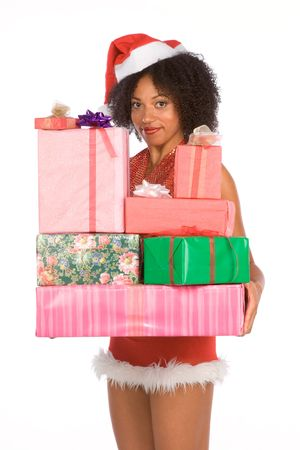 Dark skinned middle aged woman in sexy Mrs. Santa Claus outfit holding stack of gift boxes wrapped in paper and decorated by bows Stock Photo - 3712031