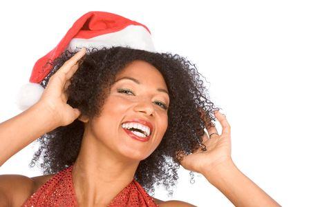 Headshot of happy gesturing attractive female in Santa hat photo