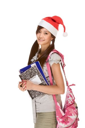 Asian school girl wearing red Santa Claus hat with backpack holding Composition book, notebooks and pen photo