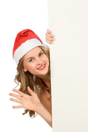 Sexy blonde young woman in Mrs Santa Claus hat holding a blank sign. Isolated on white. Extra white space with your message can be added to the right side of the picture photo