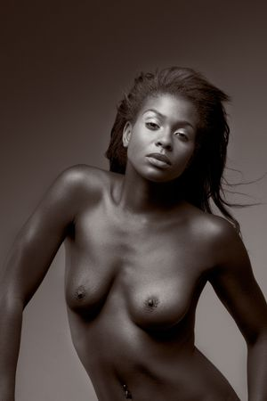 Portrait of young voluptuous sensual topless Afro American woman with navel piercing and flying hair looking into camera (monochrome toned) Stock Photo - 3832102
