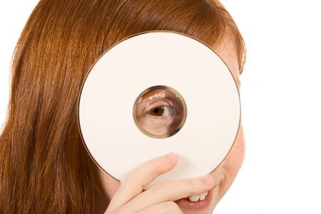 compact disk: Young girl with red hair holding a blank white compact disk CD or DVD. Isolated on white. Your text or additional graphics can be added on CDDVD cover according to your needs.