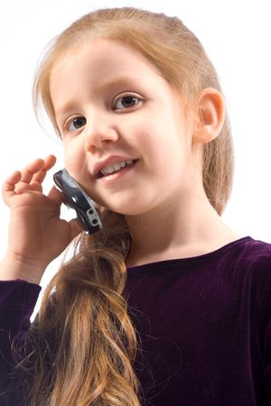 Portrait of friendly child with long gorgeous red hair calling with mobile phone and smiling. Great illustration of our times - technology reaching young generation. illustration
