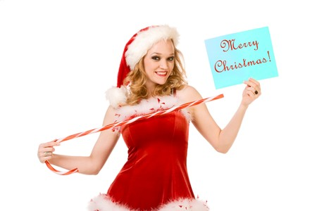 Blond sensual pinup woman in Christmas Mrs Santa Claus outfit holding sheet of paper with text Merry Christmas and points to it by huge candy cane stick. Can be used as greeting card or your text or additional graphics can be added according to needs. photo