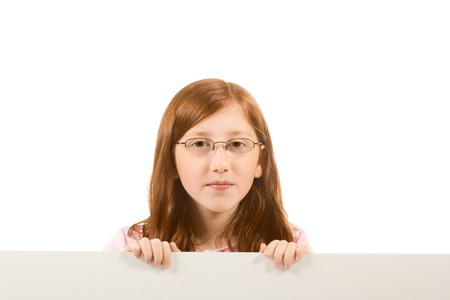 Young girl with long hair wearing glasses holding a blank sign. Isolated on white. Extra white space with your message can be added to the bottom side of the picture Stock Photo - 3944417
