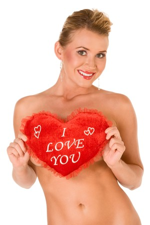 20s nude: Sexy sensual hot topless blond woman covers her by holding heart shaped pillow that had writing on it