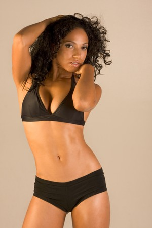 Standing attractive mid aged woman in black bra and panties project sensuality  photo