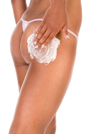 Female putting moisturizer on her buttocks (close up)  can be used as commercial advertisement for anti aging cellulite treatment products photo