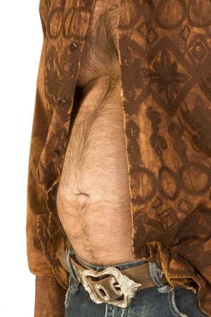 Close up of fat male abdomen section covered dark hair, wearing jeans with belt and unbuttoned shirt