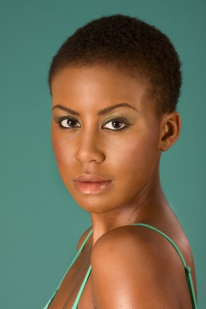 one young adult woman: Portrait of young beautiful Afro American woman with short hair wearing make up  Stock Photo