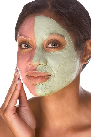 Woman with special facial mask applied on her face. The mask consist of two colors (red and green), each cover different part  photo