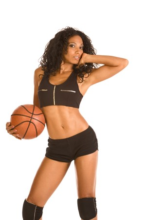 Fitness series sexy mid aged woman couch in sport clothes holding black and white basketball ball Stock Photo - 4191155