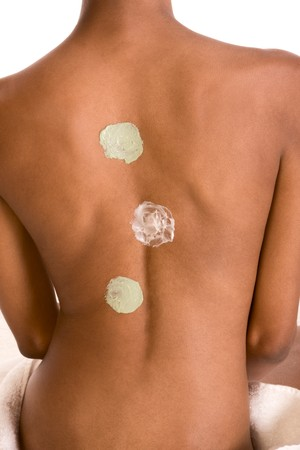 Body care ¬C African American female torso with three types of skincare product (moisturizer) applied on it. Stock Photo - 4243439