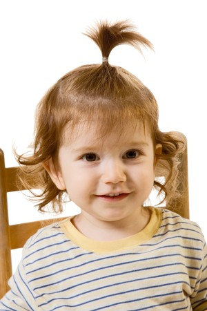 two persons only: Head and shoulders image of funny looking baby boy with long hair Stock Photo