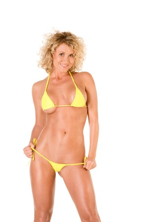 Hot sensual young blond female in skimpy yellow swimsuit Stock Photo - 4259204
