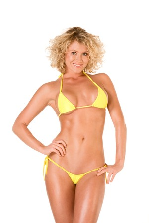 Hot sensual young blond female in skimpy yellow swimsuit photo