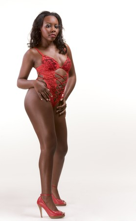 Young gorgeous black African American female in red provocative suggestive lingerie   Stock Photo