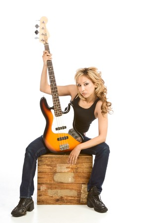 Blonde Hispanic Girl posing with electric bass guitar Stock Photo - 4389831