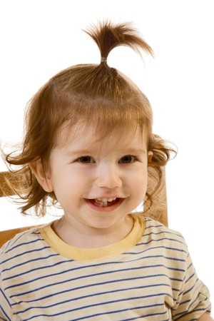 Head and shoulders image of funny looking baby boy with long hair photo