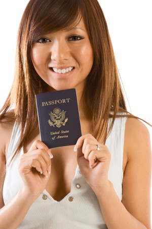 Friendly Japanese or Chinese female smiling and holding her new US passport photo