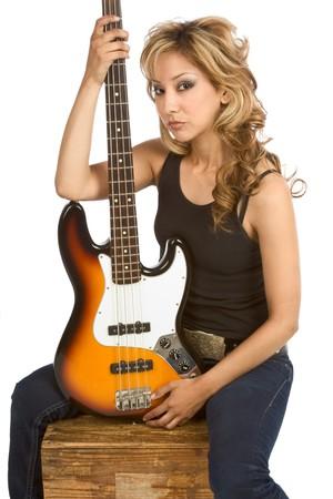 blonde hispanic: Blonde Hispanic Girl posing with electric bass guitar