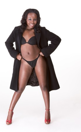 Young sexy gorgeous black African American female in black provocative suggestive lingerie and coat  photo